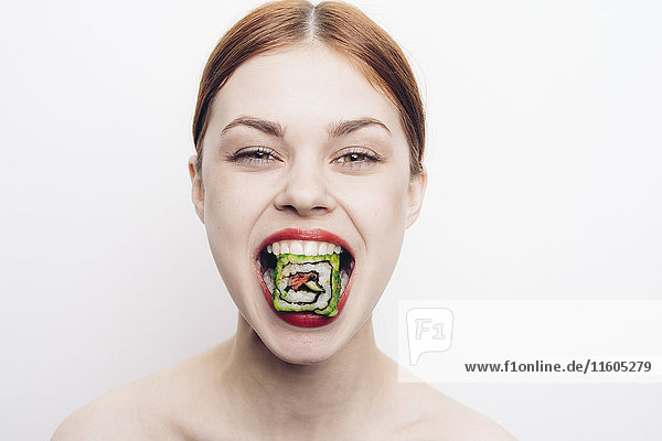 Caucasian woman with mouthful of sushi