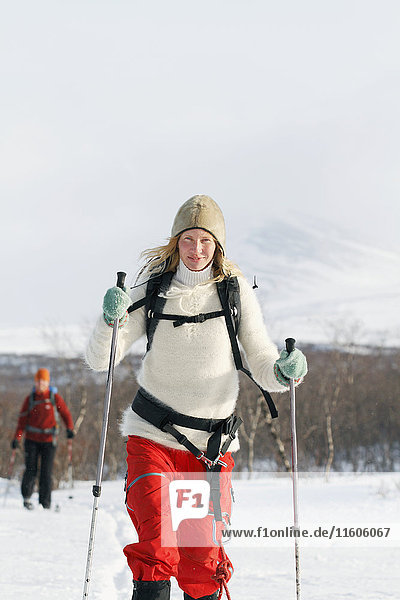 Smiling woman cross-country skiing