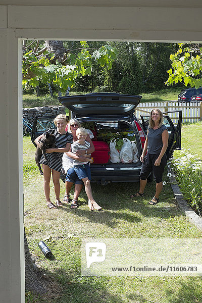 Family standing by car