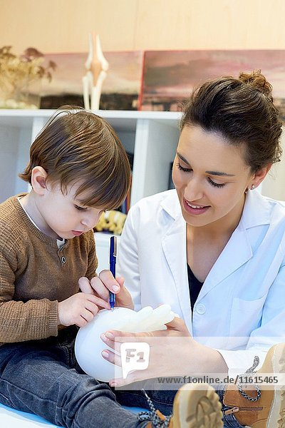 Hand child. Congenital hand. Doctor attending to patient medical consultation. Office. Plastic surgery. Pediatrician.