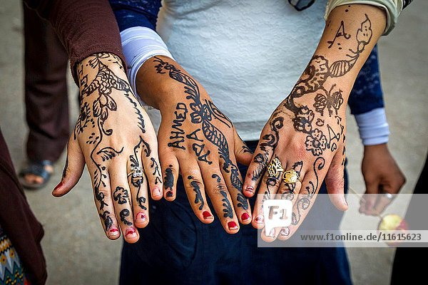 Hands decorated with henna. Mosque of Al Hussein Sayyidna next to the market Khan al-Khalili. Cairo. Cairo  Egypt.