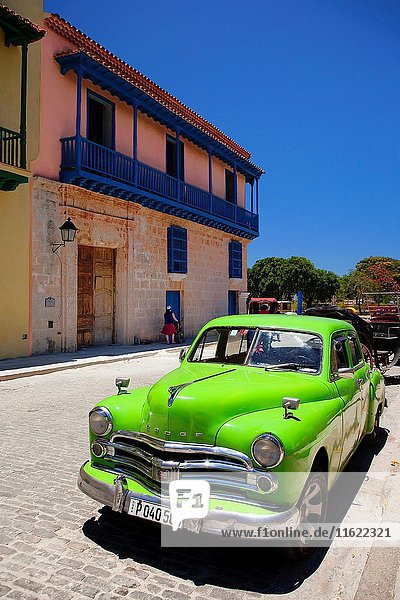 Old American car parked in front of the colonial building with balcony in Old Havana-Havana Vieja  La Habana  Cuba  Central America