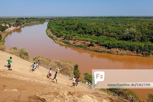 Young Ethiopian Men Running Down From Kolcho Village To The Omo River  Omo Valley  Ethiopia.