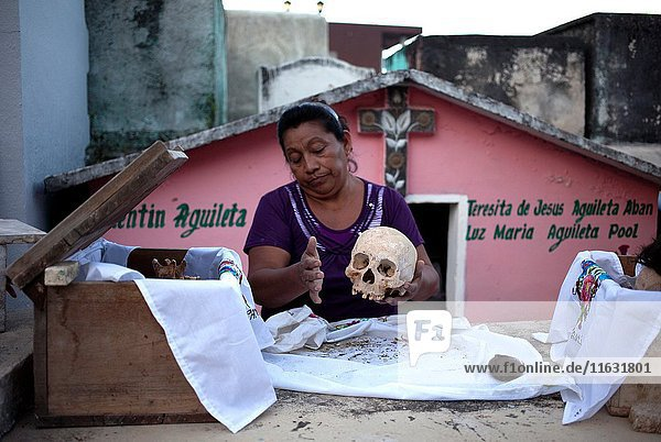 A woman cleans the bones of a deceased family member in the Mayan village of Pomuch  Hecelchakan  Campeche  Yucatán península  October 30  2016  as part of Day of the Dead celebrations in Mexico City  a Catholic celebration that honors the deceased. Pomuch is the only village in Mexico the neighboors clean the bones of their families.
