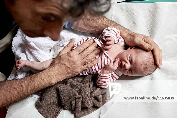 Reportage on a midwife in Lyon  France. Consultation with a 2-week old baby.