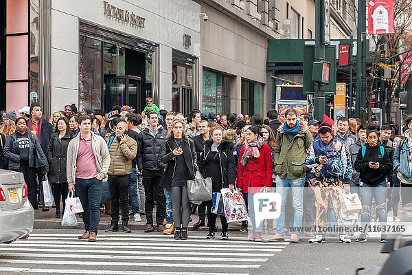Hordes of shoppers in Herald Square in New York looking for bargains on the day after Thanksgiving  Black Friday  November 25  2016. Sales online are expected to increase 20 percent with store traffic expected to decrease between 3 and 4 percent this year.