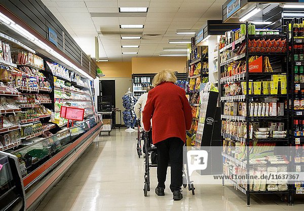 Senior citizens in the aisles of a supermarket in New York