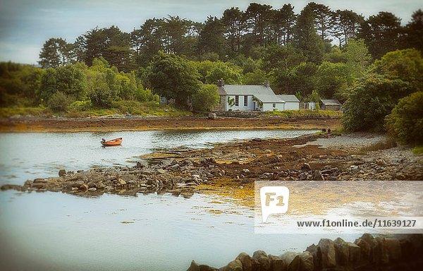 Near Ahakista  on the Sheep's Head peninsula  County Cork  Republic of Ireland. Eire. House on an inlet.