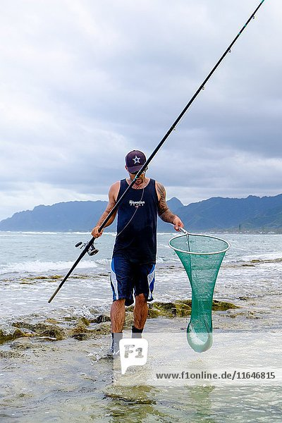 LAIE  HAWAII - FEBRUARY 24  2017: Fisherman Jameson Humalon competes in a saltwater fishing tournament on Oahu targeting bonefish on the windward side of the island.