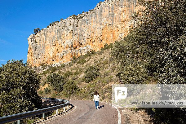 Young Woman on Road in Canyon Landscape  Nuevalos  Aragon  Spain.