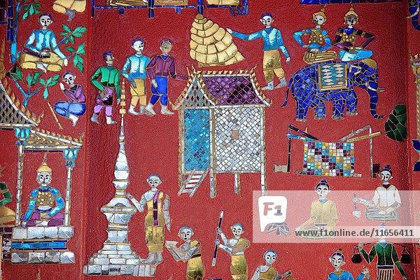Laos  Luang Prabang  Wat Xieng Thong  mosaics  buddhist temple .