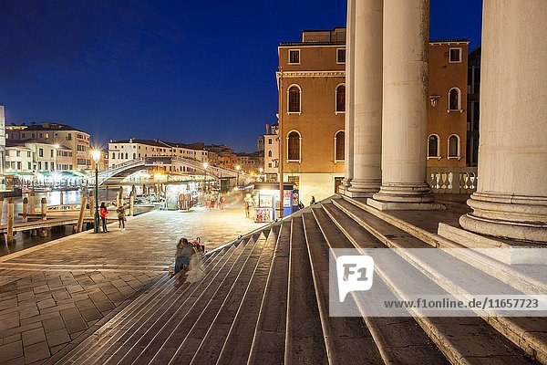 Night falls at the entrance to San Simeone Piccolo church in the sestier of Santa Croce  Venice  Italy.