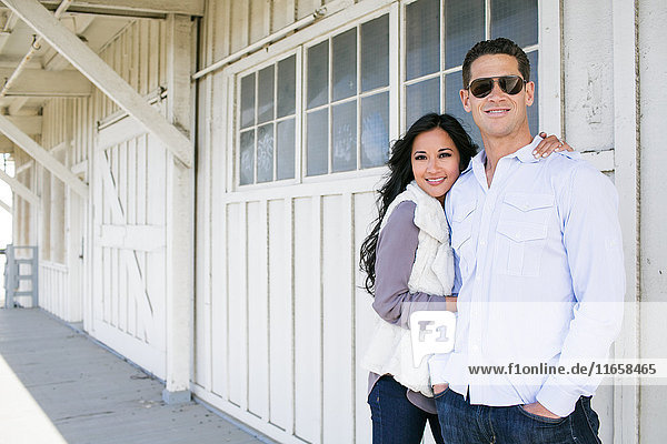 Portrait of mid adult woman and boyfriend outside chalet