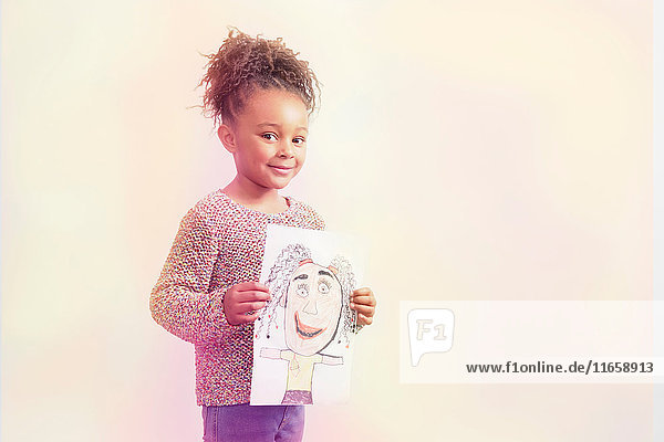 Portrait of young girl  holding drawing  smiling