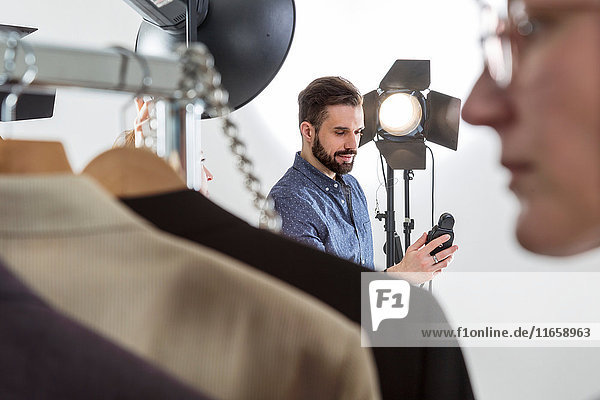 Stylist and photographer preparing in photography studio