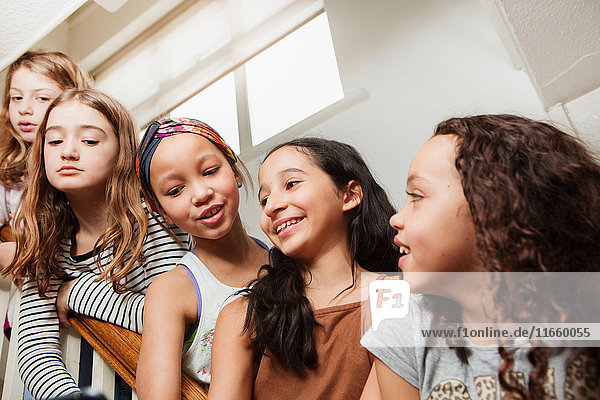 Girls on stairs looking at camera