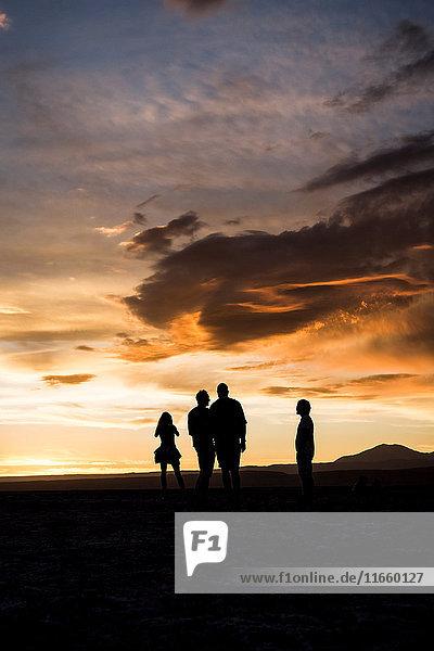 Silhouette of people in desert at sunset  San Pedro de Atacama  Chile
