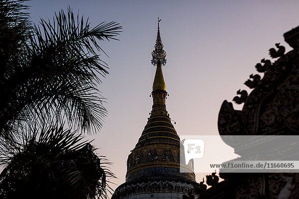 Buddhist temple spires at dusk  Chiang Mai  Thailand