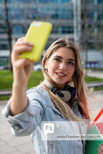Young woman  outdoors  taking selfie with smartphone