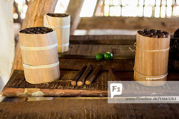 Three packages of hand made cuban cigars on workbench  Vinales  Cuba