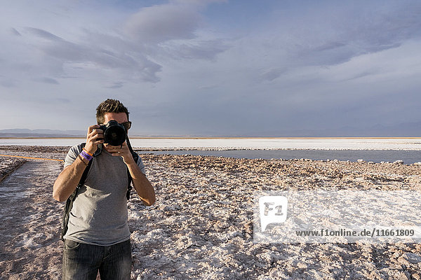 Photographer on snow covered landscape  San Pedro de Atacama  Chile