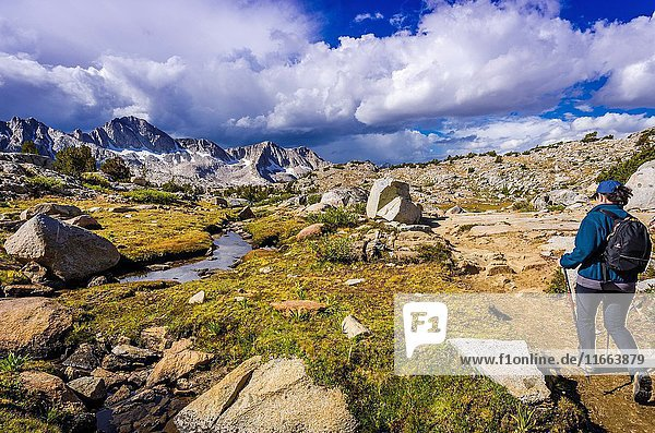 Hiker on the Bishop Pass trail in Dusy Basin  Kings Canyon National Park  California USA.