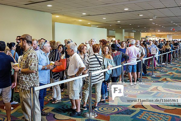 Florida  Miami Beach  Convention Center  Art Basel  art fair  exhibition  interior  long ticket line  queue  man  woman  crowded