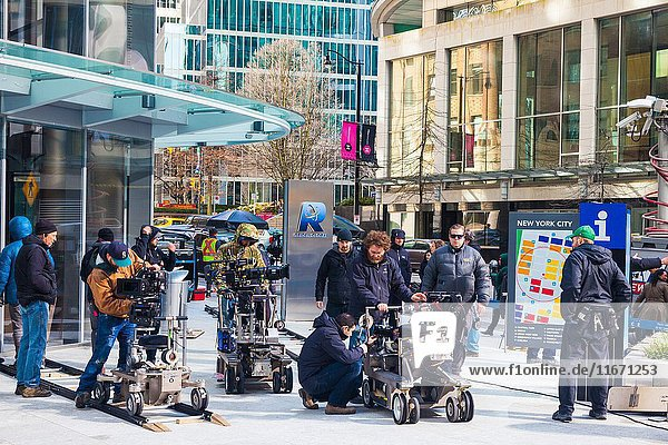 Movie set on the streets of Vancouver simulating a crowd protest in New York City.