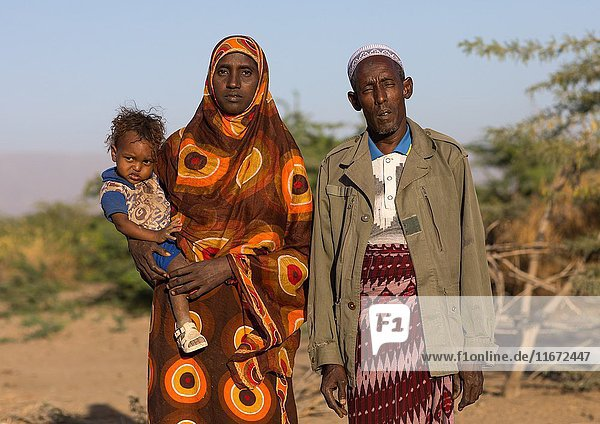 Afar tribe man with his wife and child  Afar region  Afambo  Ethiopia.