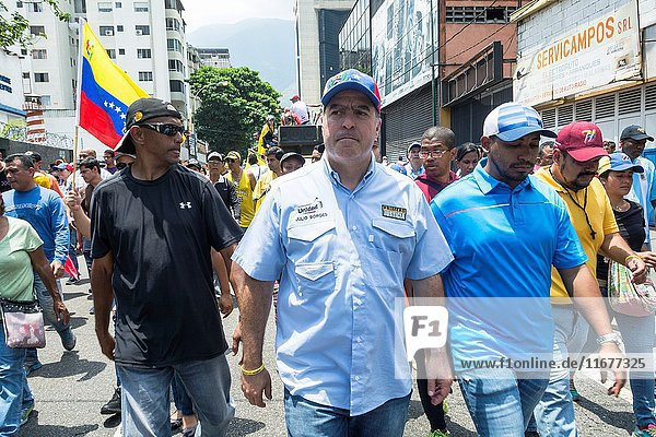 Julio Borges  President of the National Assembly walks in a concentration in the streets of Caracas  against the government of Nicolas Maduro. Opponents march once more through the streets and freeways of Caracas against the government of Nicolás Maduro on April 26  2017.