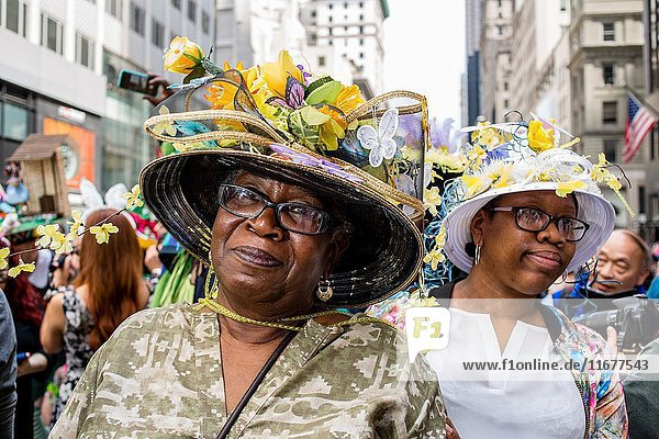New York  NY - April 16  2017. A woman with an elaborate hat with decorations of flowers and butterflies at New York's annual Easter Bonnet Parade and Festival on Fifth Avenue.