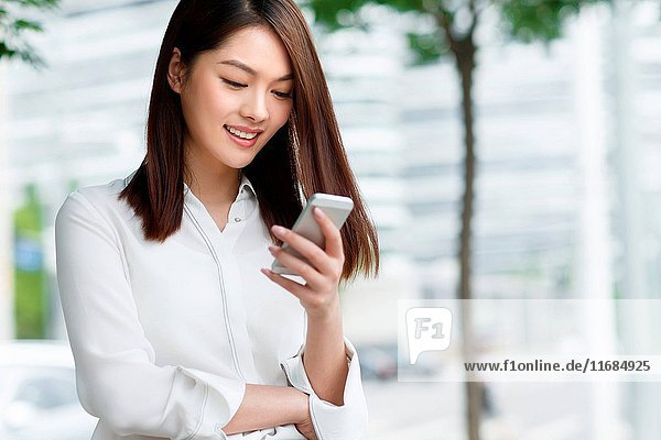 Young women using mobile phones
