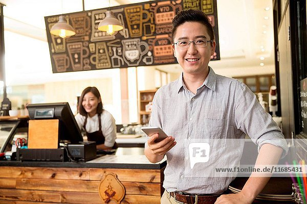 The waiter and the customer in the cafe