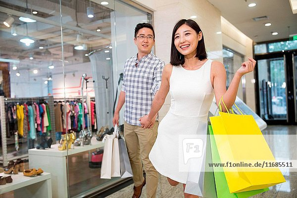 Young lovers shopping mall
