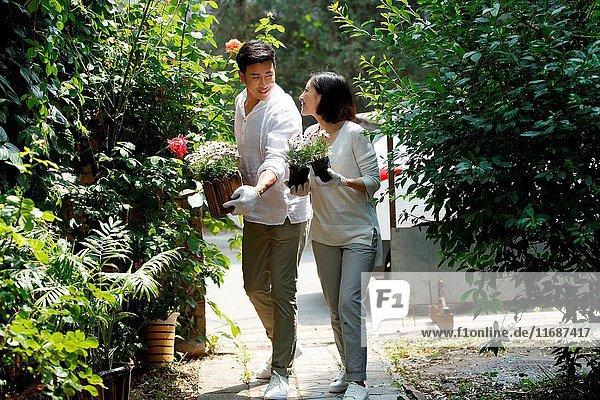 Young couple gardening in backyard