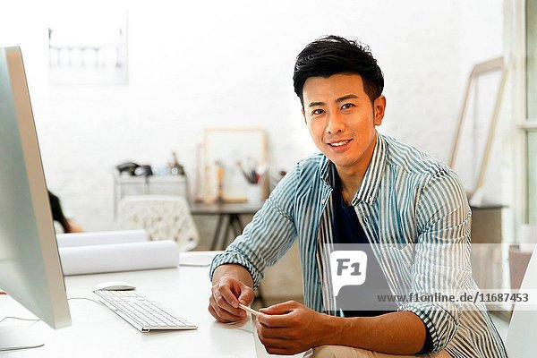 Young man using computer at home