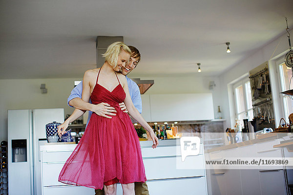 Couple dancing together in kitchen