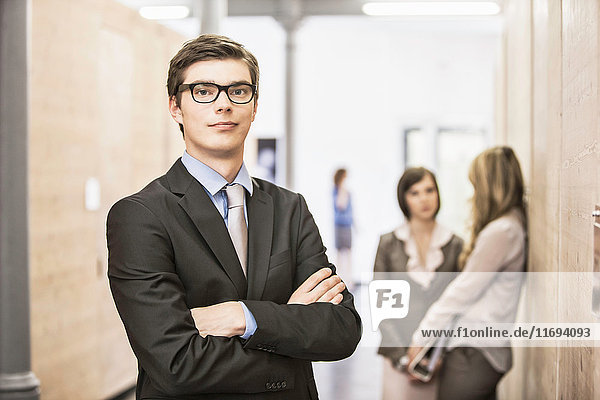 Businessman standing in hallway