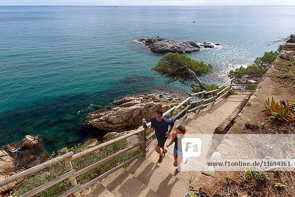 Couple running on paved steps
