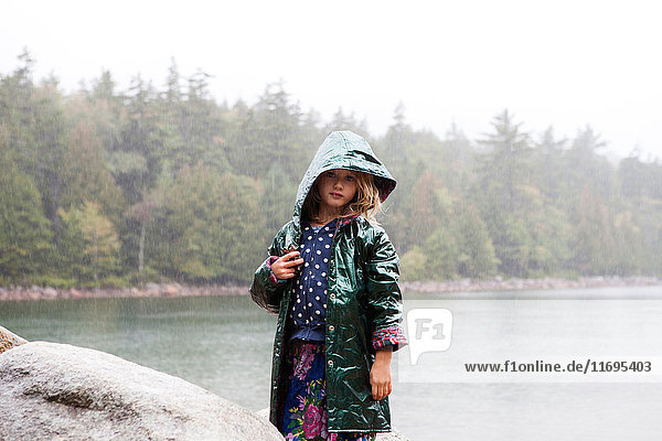 Girl in the rain at Acadia National Park  Maine  USA