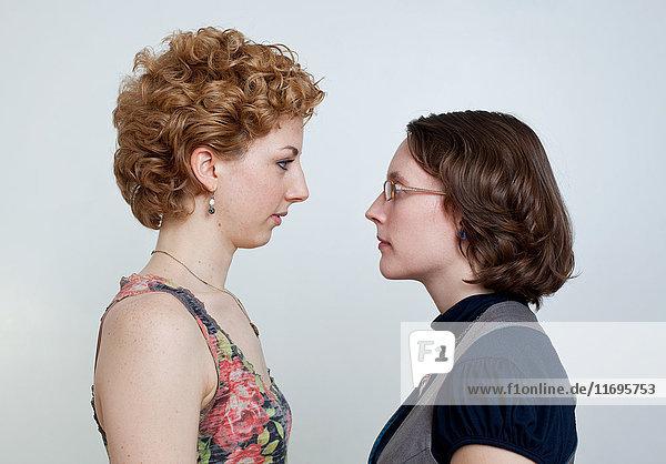 Lesbian couple face to face  studio shot