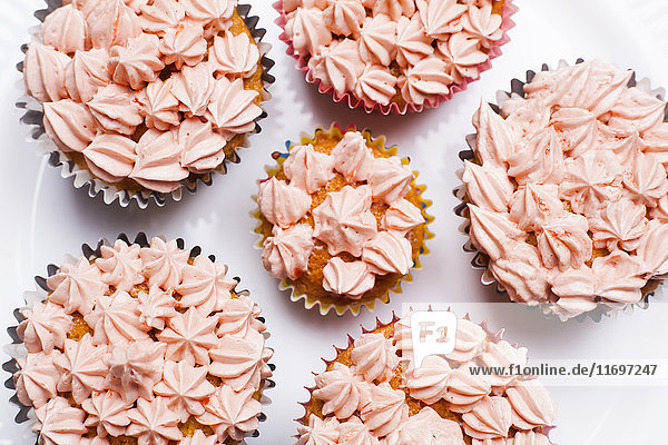 Close up of cupcakes with pink frosting
