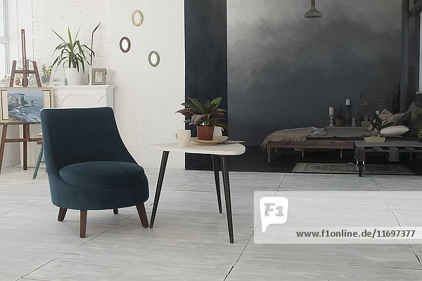 Armchair and table in livingroom