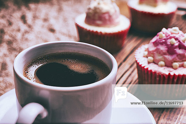 Close up of coffee and cupcakes