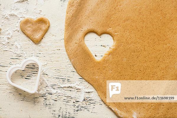 Heart shape cut from cookie dough
