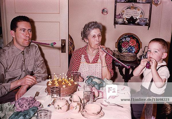 Multi-generation family celebrating birthday