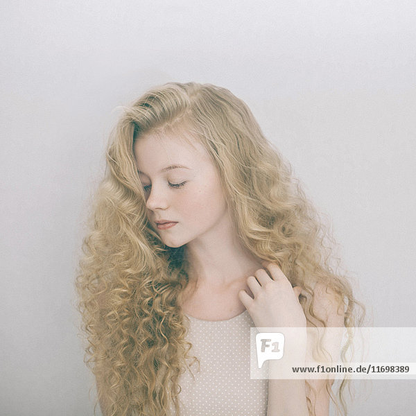 Portrait of Caucasian teenage girl with blonde hair