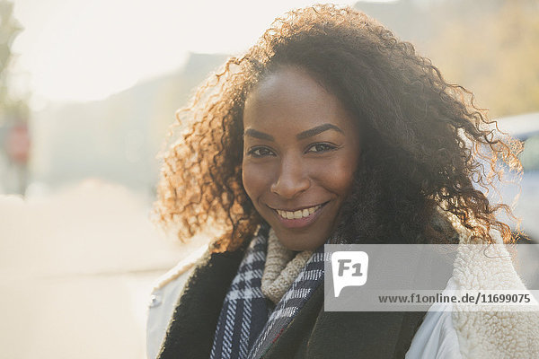 Portrait smiling young woman wearing scarf