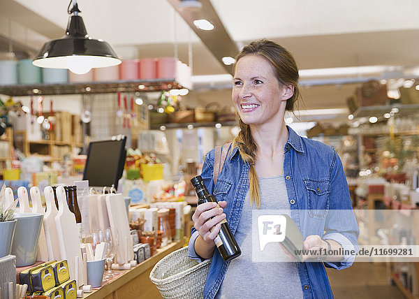 Smiling pregnant woman shopping in shop