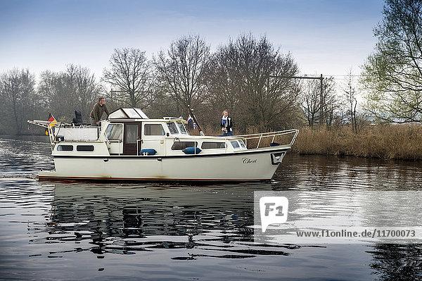 Netherlands  Friesland  Haskerdijken  couple on motorboat